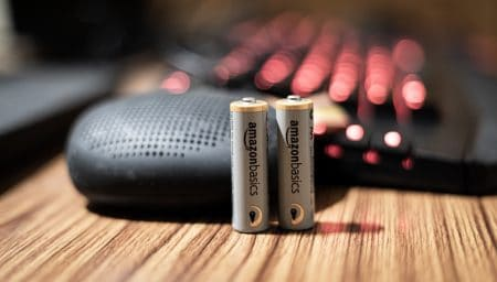 gray and gold battery on brown wooden table